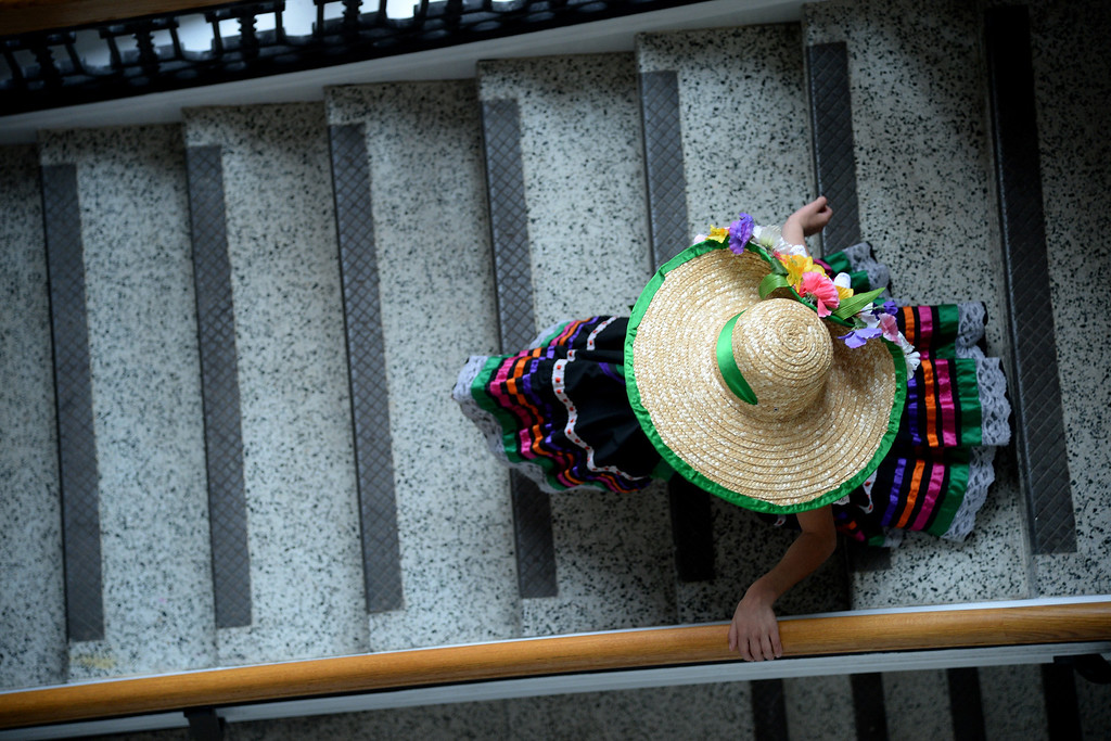 . Brehanna Andrade walks down the stairs of the McNichols building after her group\'s performance. The Día del Niño celebration of culture on Sunday, April 27, 2014. (Photo By AAron Ontiveroz/ The Denver Post)