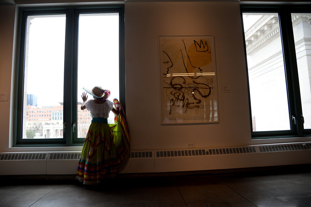 . Natasha Andrade looks out the window after her performance. The Día del Niño celebration of culture on Sunday, April 27, 2014. (Photo By AAron Ontiveroz/ The Denver Post)