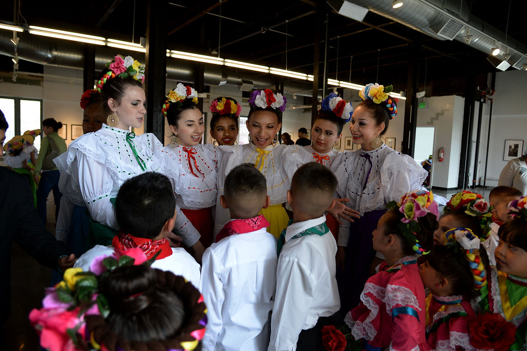 . Older students from Lisa T\'s Dance Academy speak to the younger dancers before taking the stage. The Día del Niño celebration of culture on Sunday, April 27, 2014. (Photo By AAron Ontiveroz/ The Denver Post)