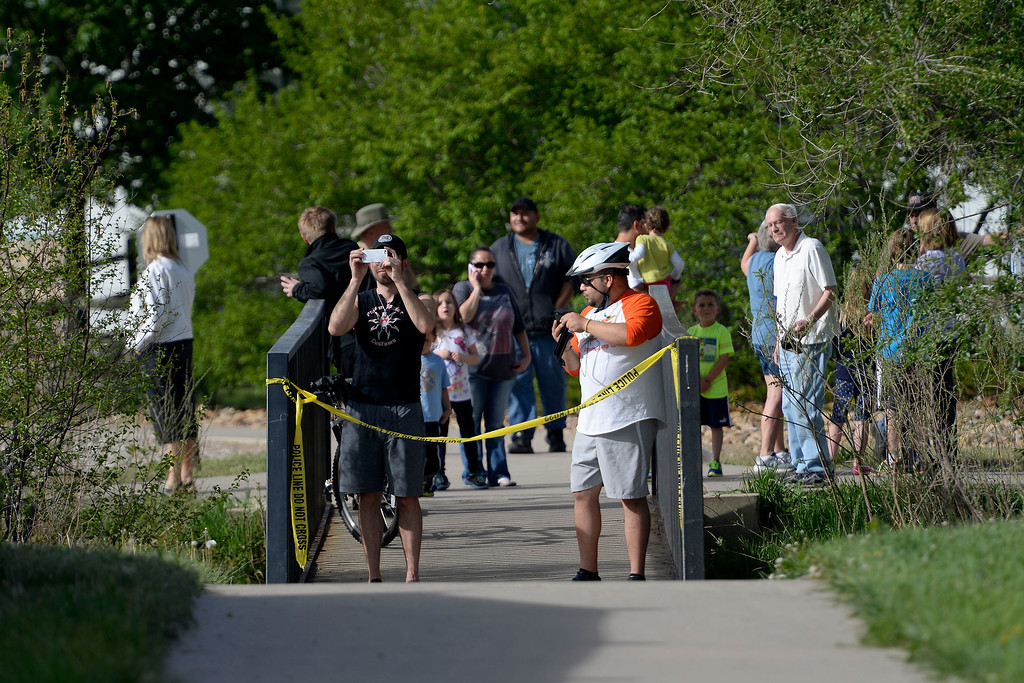 . People take pictures of the scene of the crash. A plane crashed into a home in Northglenn 110th Avenue and Livingston on May 5, 2014. (Photo by AAron Ontiveroz/The Denver Post)