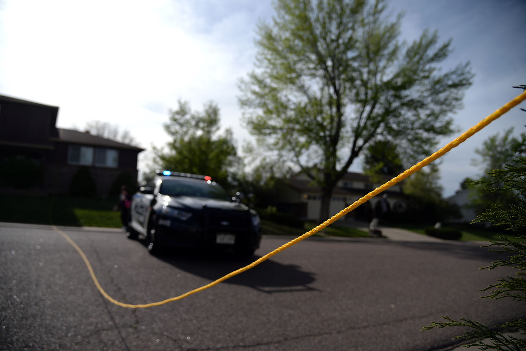 . The rope that was attached to the banner of the plane that crashed into a Northglenn home lays on the street over a tree, bush and a house. A plane crashed into a home in Northglenn 110th Avenue and Livingston on May 5, 2014. (Photo by AAron Ontiveroz/The Denver Post)