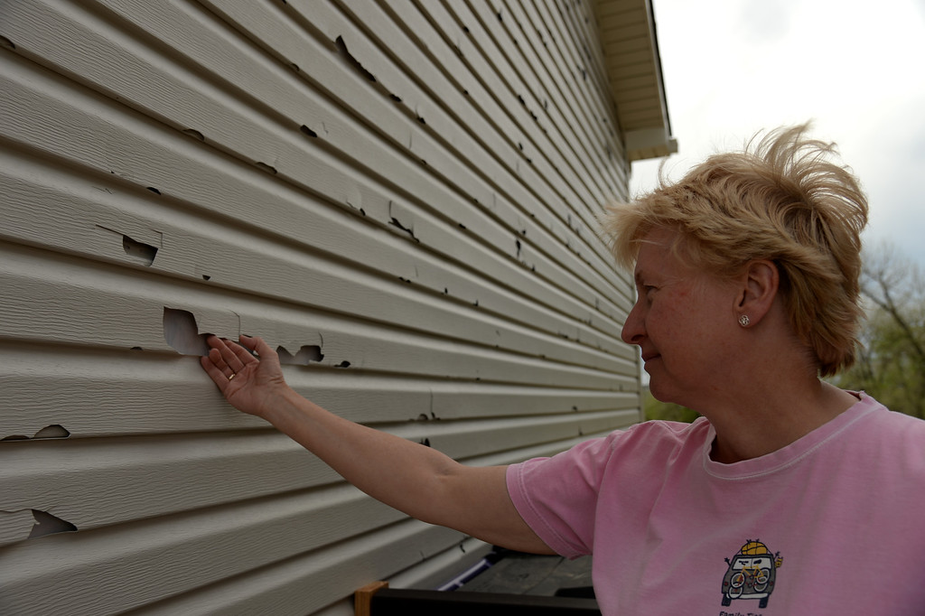 . DENVER MAY 22: Laura Sarson of Green Valley Ranch is checking her house damaged by hail from Wednesday storm. Denver, Colorado. May 22. 2014. (Photo by Hyoung Chang/The Denver Post)
