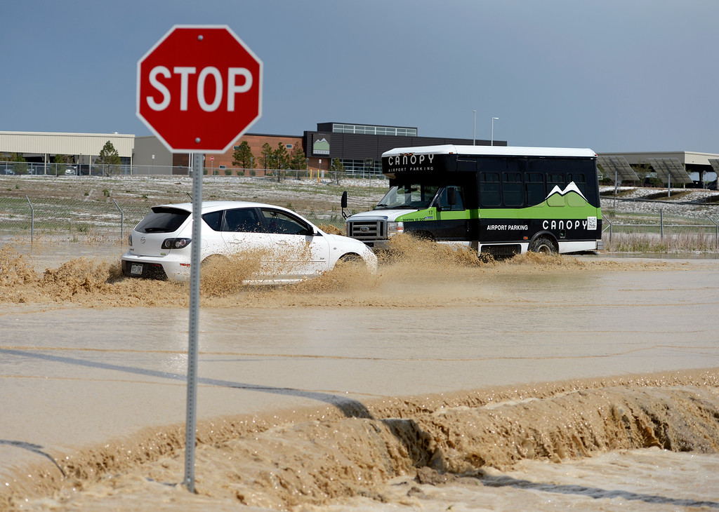 . DENVER, CO - MAY 21: Drivers proceeded with caution as water covered Tower Road following a storm Wednesday afternoon, May 21, 2014.  (Photo by Karl Gehring/The Denver Post)