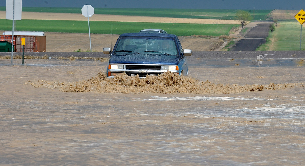 . ADAMS COUNTY, CO. - MAY 21: Flooding on 56th Ave east of Denver International Airport was an adventure for drivers Wednesday afternoon (Photo by Steve Nehf, The Denver Post)