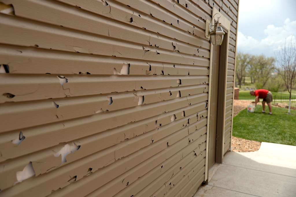 . DENVER MAY 22: Houses in Green Valley Ranch is damaged by hail from Wednesday storm. Denver, Colorado. May 22. 2014. (Photo by Hyoung Chang/The Denver Post)