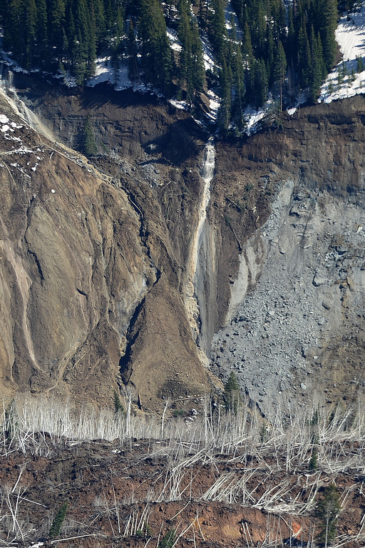 . An Aerial view of of a waterfall in the Mesa County Mudslide as seen from a plane flown by John Stanley The Mesa County Mudslide, which occurred on Sunday evening and is being measured in miles as opposed to merely feet, Monday, May 26, 2014. (Photo by AAron Ontiveroz/The Denver Post)