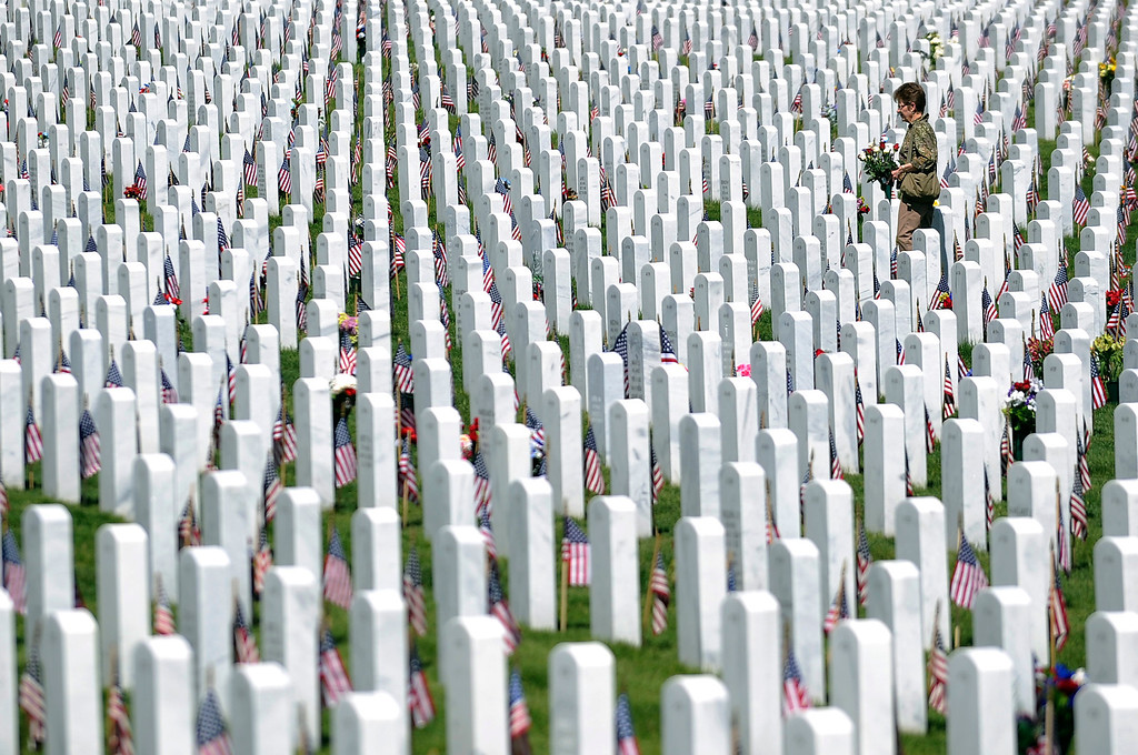 . Glenda Amerine searches for her husband, Maynard D Amerine\'s, grave during a Memorial Day ceremony at Fort Logan Cemetery in Denver, Colorado on May 26, 2014. (Photo by Seth McConnell/The Denver Post)