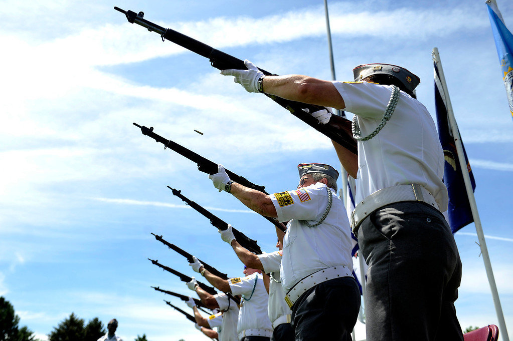 . VFW Post 9644 Honor Guard performs a Memorial Rifle Salute during a Memorial Day ceremony at Fort Logan Cemetery in Denver, Colorado on May 26, 2014. (Photo by Seth McConnell/The Denver Post)