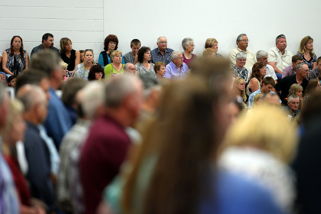 . The gym is packed to capacity, forcing many outside, during the memorial service for the three men who died in the Mesa County mudslide. Hundreds of community members gathered for the memorial service at Plateau Valley High School on Sunday, June 01, 2014. (Photo by AAron Ontiveroz/The Denver Post)