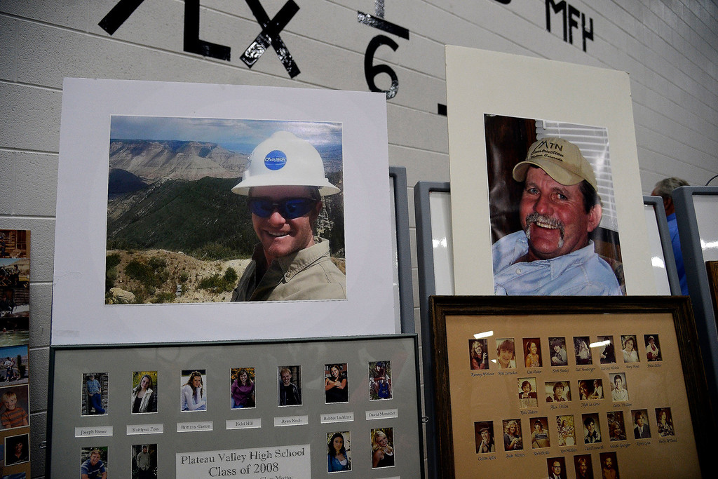 . Photos of Danny Nichols (left) and Clancy Nichols during the memorial service for them and Wes Hawkins who went missing in the Mesa County mudslide. Hundreds of community members gathered for the memorial service at Plateau Valley High School on Sunday, June 01, 2014. (Photo by AAron Ontiveroz/The Denver Post)