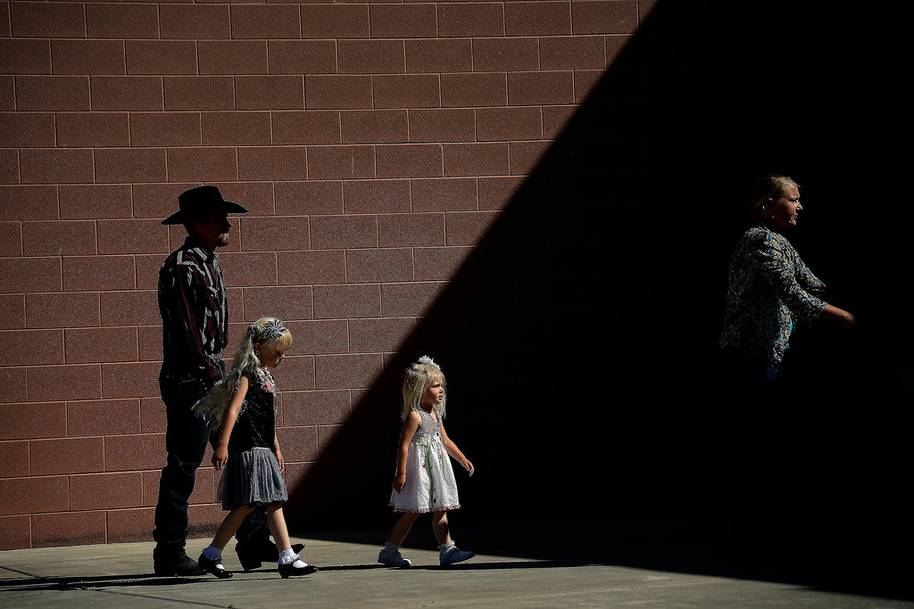 . Droves of people arrive for the memorial service for the three men who went missing in the Mesa County mudslide. Hundreds of community members gathered for the memorial service at Plateau Valley High School on Sunday, June 01, 2014. (Photo by AAron Ontiveroz/The Denver Post)