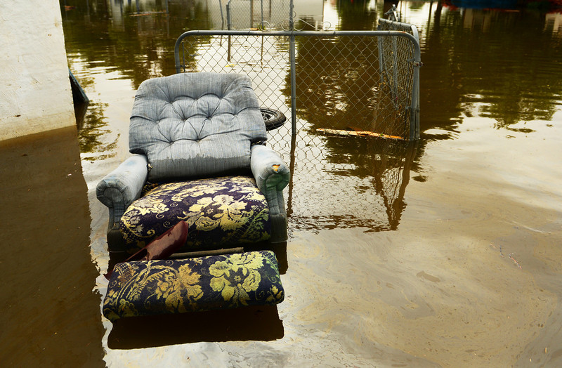 . A chair sits in flood water outside a home on 5th Street in Greeley due to rising water along the Poudre River, June 4, 2014. A flood warning for the Poudre River near Greeley has been extended through Sunday. (Photo by RJ Sangosti/The Denver Post)