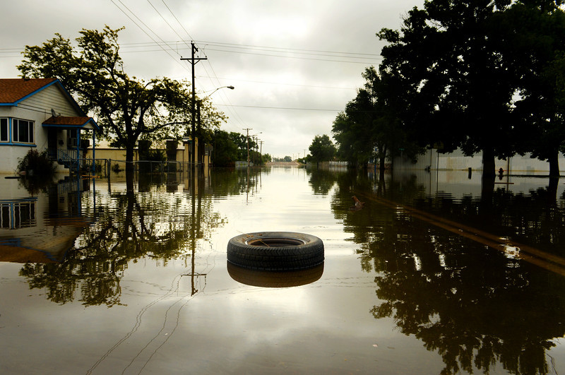 . A tire floats along 5th Street in Greeley due to rising water along the Poudre River, June 4, 2014. A flood warning for the Poudre River near Greeley has been extended through Sunday. (Photo by RJ Sangosti/The Denver Post)