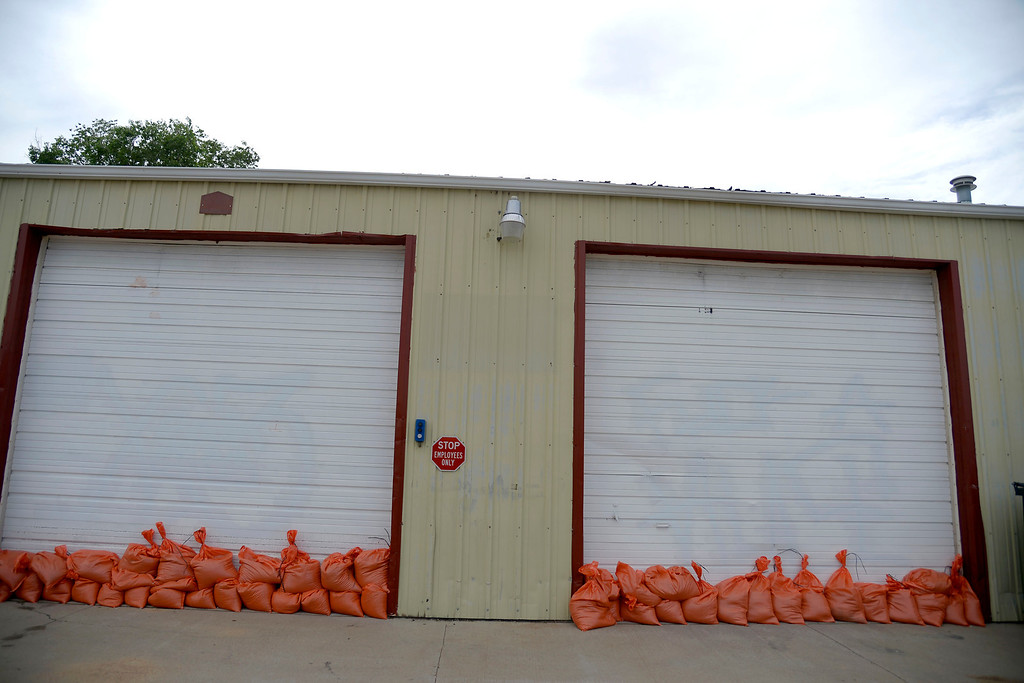 . A garage is prepared for flood waters after an area of town flooded. A heavy rain caused parts of Greeley to flood on Monday, June 2, 2014. (Photo by AAron Ontiveroz/The Denver Post)