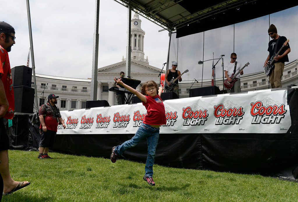 ". DENVER, CO - JUNE 8: Isabella Shaw, 8, breaks out in a dance with a performance by P-Nuckle. The Annual CHUN Capitol Hill People\'s Fair takes place at Civic Center Park in downtown Denver. The fair emphasizes ""bringing together a diverse population to celebrate community and enjoy the start of the summer festival season\"". The fair includes live entertainment with vendors selling food, arts and crafts, kids activities as well as numerous non-profits representing various organizations. The event runs through Sunday, 10 am to 7 pm. (Photo by Kathryn Scott Osler/The Denver Post)"
