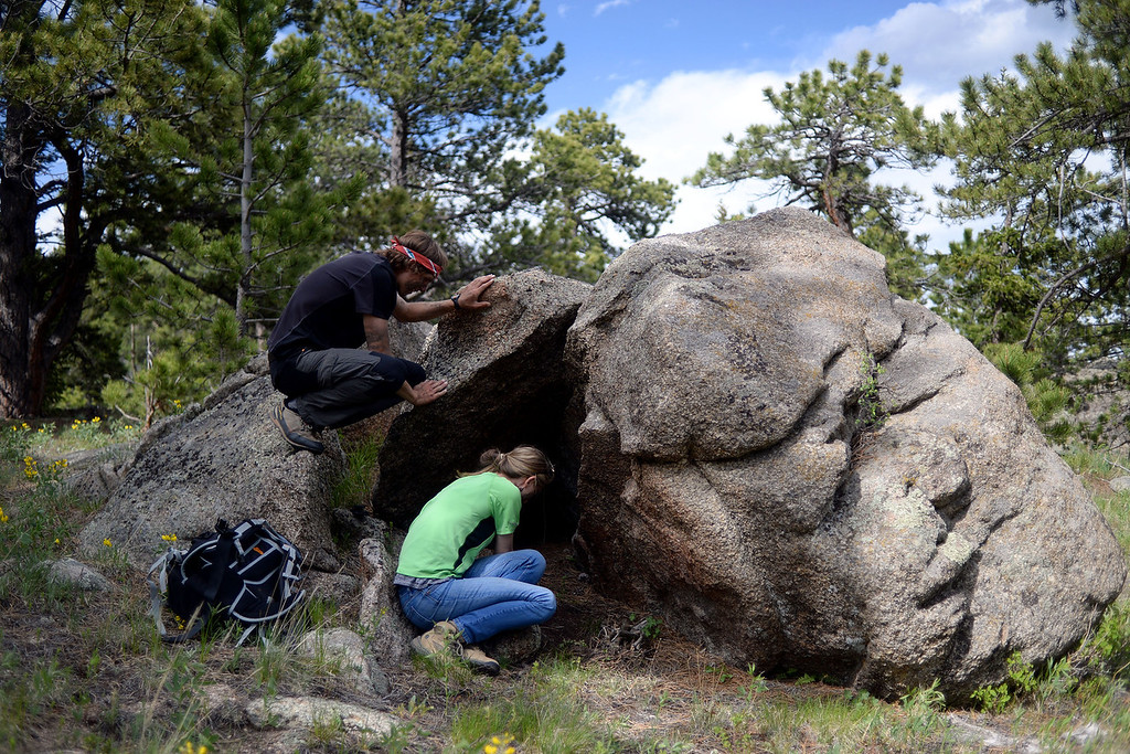 . WARD, CO - JUNE 10: Instructor Anthony Handal looks over student Elizabeth Beem as she builds her fire beneath a couple rocks. Bear Grylls survival school at Glacier View Ranch near Ward, Colorado on Tuesday, June 10, 2014. (Photo by AAron Ontiveroz/The Denver Post)