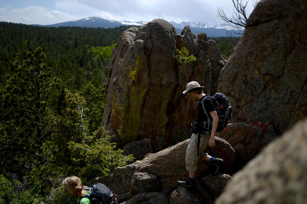 . WARD, CO - JUNE 10: Landon Rolfe hikes through the course. Bear Grylls survival school at Glacier View Ranch near Ward, Colorado on Tuesday, June 10, 2014. (Photo by AAron Ontiveroz/The Denver Post)