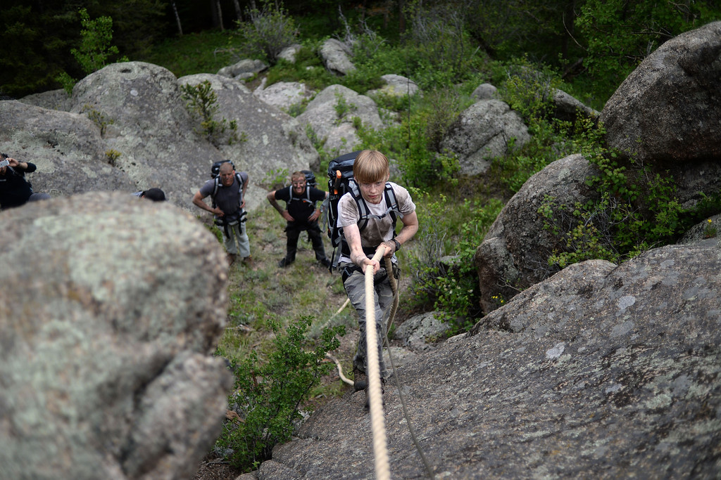 . WARD, CO - JUNE 10: Taylor Bond works his way up a boulder by way of a rope. Bear Grylls survival school at Glacier View Ranch near Ward, Colorado on Tuesday, June 10, 2014. (Photo by AAron Ontiveroz/The Denver Post)