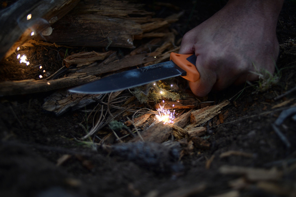 . WARD, CO - JUNE 10: A student uses a knife to spark a fire. Bear Grylls survival school at Glacier View Ranch near Ward, Colorado on Tuesday, June 10, 2014. (Photo by AAron Ontiveroz/The Denver Post)