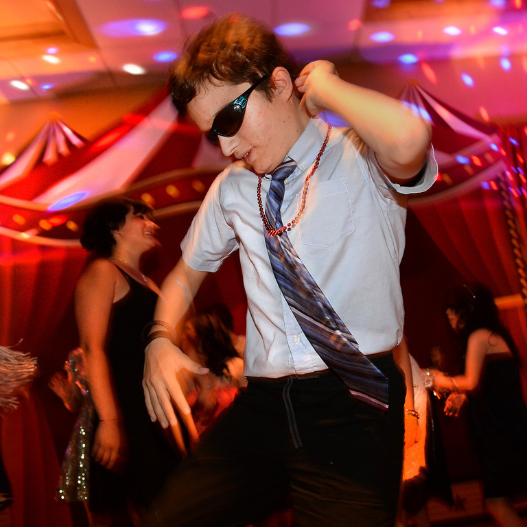 . DENVER, CO - JUNE 13: Caleb Stewart, age 16, showed off his dance moves at the Children\'s Hospital Prom Friday night. Children\'s Hospital hosted a prom for teens that might have missed their regular prom due to medical issues. The event was held at the Double Tree Hotel Friday night, June 13, 2014. The prom provides patients to have the opportunity to experience one of the biggest rites of teen passage. (Photo by Karl Gehring/The Denver Post)