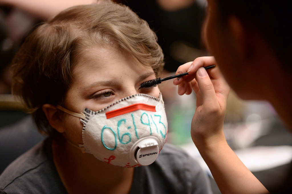 . DENVER, CO - JUNE 13:Stylist Lilly Sowder, right, applied makeup for Ashleigh Orosz, age 15, before the Children\'s Hospital prom Friday night. Orosz will soon celebrate the one year anniversary of her bone marrow transplant, the date of which is printed on the face mask she wears.  Children\'s Hospital hosted a prom for teens that might have missed their regular prom due to medical issues. The event was held at the Double Tree Hotel Friday night, June 13, 2014. The prom provides patients to have the opportunity to experience one of the biggest rites of teen passage. (Photo by Karl Gehring/The Denver Post)