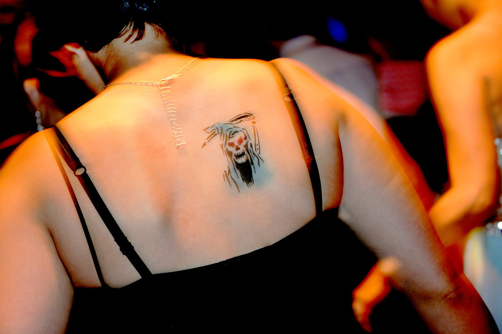 . DENVER, CO - JUNE 13: Breeanna Housden, age 17, had a temporary tattoo of the Grim Reaper airbrushed on her back for the night. Children\'s Hospital hosted a prom for teens that might have missed their regular prom due to medical issues. The event was held at the Double Tree Hotel Friday night, June 13, 2014. The prom provides patients to have the opportunity to experience one of the biggest rites of teen passage. (Photo by Karl Gehring/The Denver Post)
