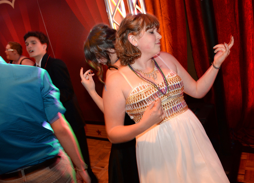 . DENVER, CO - JUNE 13: Lauren Alfino, age 18, played the air guitar during the final song of the night. Alfino has been cancer-free for a year now after chemotherapy treatments for her Non-Hodgkins Lymphoma. Children\'s Hospital hosted a prom for teens that might have missed their regular prom due to medical issues. The event was held at the Double Tree Hotel Friday night, June 13, 2014. The prom provides patients to have the opportunity to experience one of the biggest rites of teen passage. (Photo by Karl Gehring/The Denver Post)