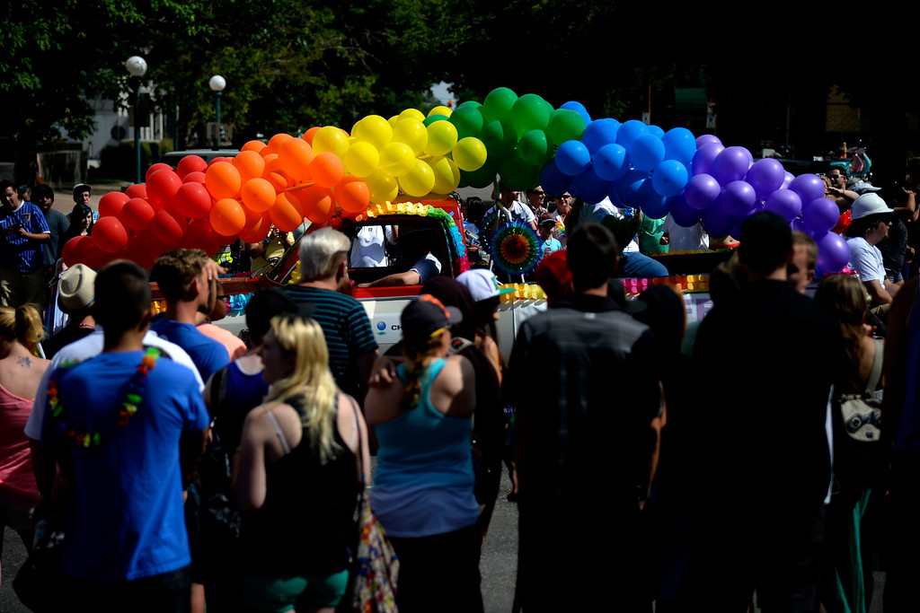 . DENVER, CO - JUNE 22: A float carrying a rainbow of balloons passes the crowd near the state capitol during PrideFest 2014 in downtown Denver. Thousands of people gathered in the city to enjoy a bevy of events including dancing, food and music on Sunday, June 22, 2014. (Photo by AAron Ontiveroz/The Denver Post)