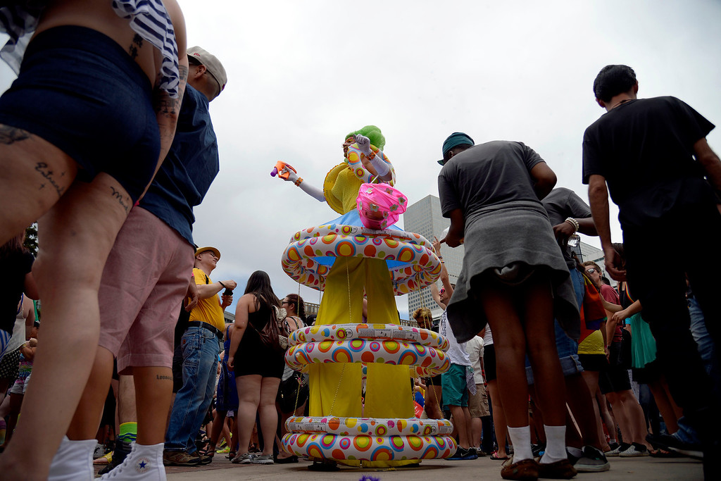 . DENVER, CO - JUNE 22: Performer Nucliawaste dances on stilts with the crowd during PrideFest 2014 in downtown Denver. Thousands of people gathered in the city to enjoy a bevy of events including dancing, food and music on Sunday, June 22, 2014. (Photo by AAron Ontiveroz/The Denver Post)