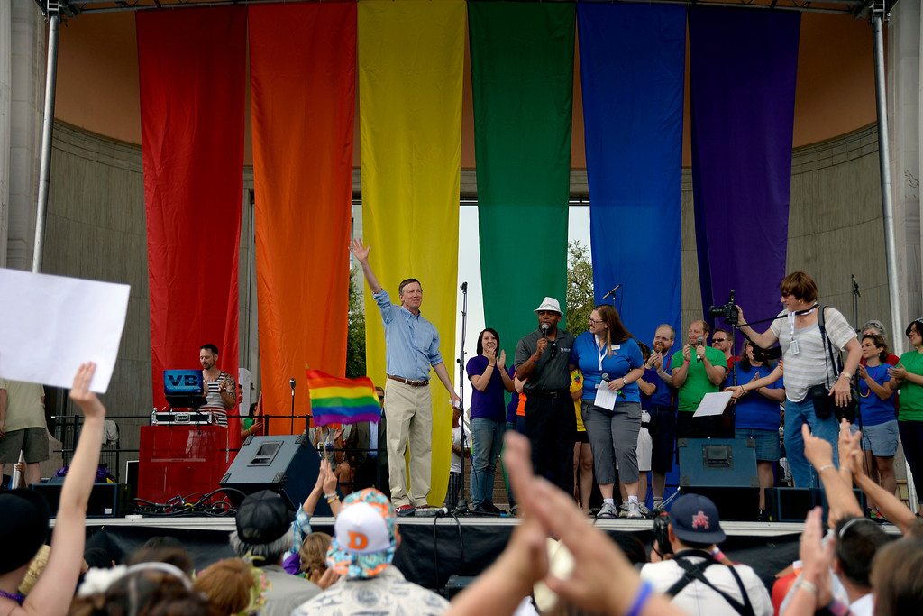 . DENVER, CO - JUNE 22: Governor John Hickenlooper and mayor Michael B. Hancock greet the crowd during PrideFest 2014 in downtown Denver. Thousands of people gathered in the city to enjoy a bevy of events including dancing, food and music on Sunday, June 22, 2014. (Photo by AAron Ontiveroz/The Denver Post)