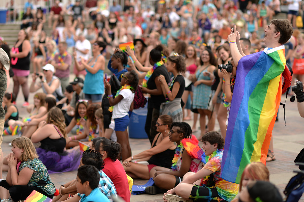 . DENVER JUNE 21: Walt Pierte of Houston, TX. with Rainbow frag and people are enjoying the events of main stage of 2014 Denver Pridefest at Civic Center Park in Denver, Colorado June 21, 2014.The festival kicks off with many events. (Photo by Hyoung Chang/The Denver Post)