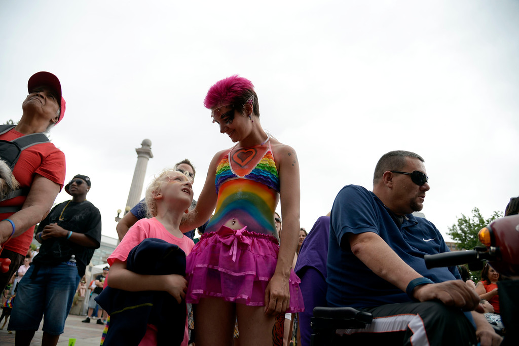 . DENVER, CO - JUNE 22: Tessa Baldwin talks to her son, Connor, 7, during PrideFest 2014 in downtown Denver. Thousands of people gathered in the city to enjoy a bevy of events including dancing, food and music on Sunday, June 22, 2014. (Photo by AAron Ontiveroz/The Denver Post)