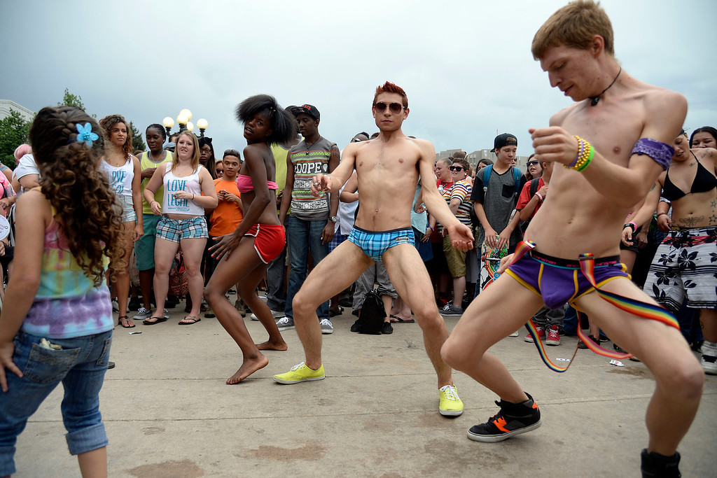 . DENVER, CO - JUNE 22: Lillian Smith, Roman Martinez and Pierce Magnus dance during PrideFest 2014 in downtown Denver. Thousands of people gathered in the city to enjoy a bevy of events including dancing, food and music on Sunday, June 22, 2014. (Photo by AAron Ontiveroz/The Denver Post)