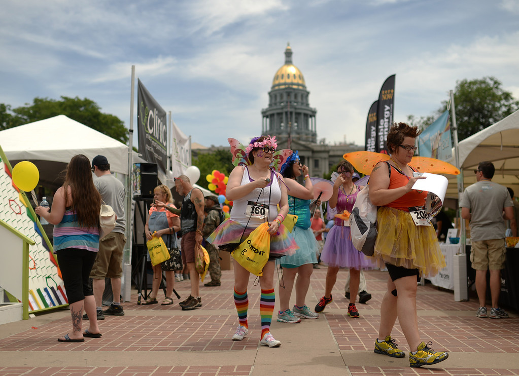 . DENVER JUNE 21: Dee Hanes (160) and Rainbow Fairys are in the Civic Center Park to celebrate the 2014 Denver Pridefest after their Big Gay 5K Run/Walk in Denver, Colorado June 21, 2014. (Photo by Hyoung Chang/The Denver Post)