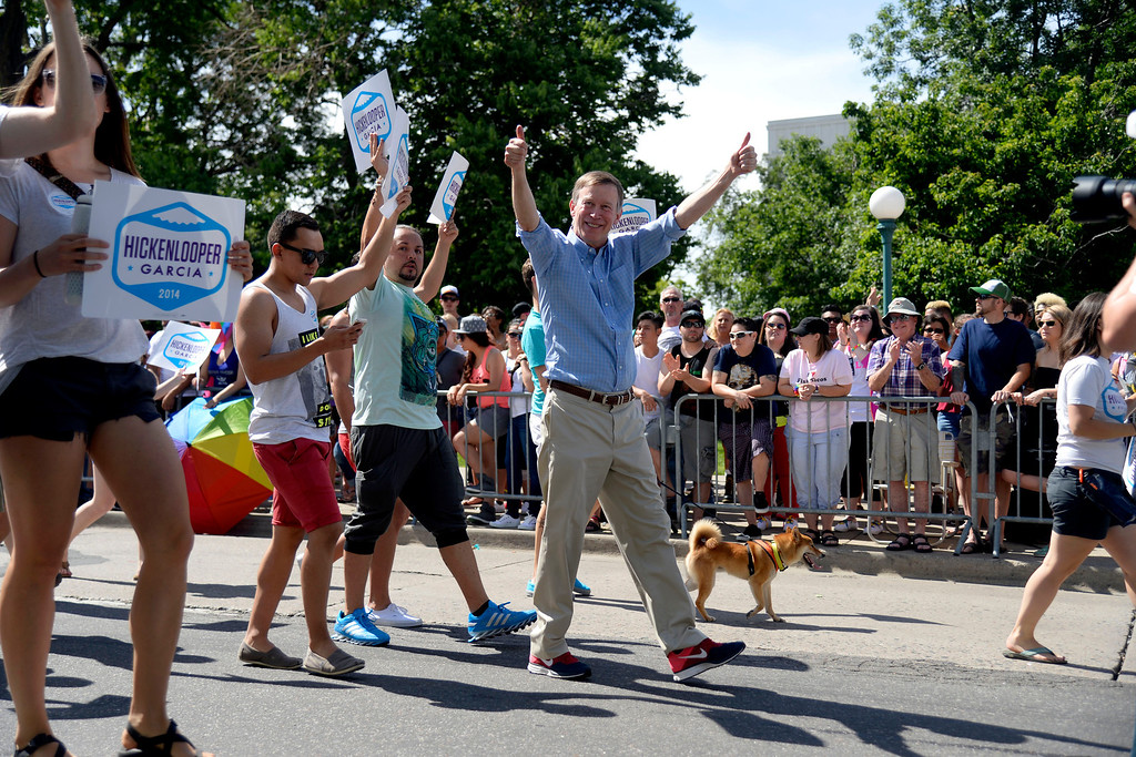 . DENVER, CO - JUNE 22: Governor John Hickenlooper gives a double thumbs up to the crowd during PrideFest 2014 in downtown Denver. Thousands of people gathered in the city to enjoy a bevy of events including dancing, food and music on Sunday, June 22, 2014. (Photo by AAron Ontiveroz/The Denver Post)