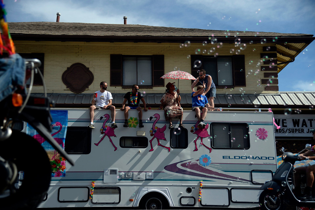 . DENVER, CO - JUNE 22: A group of men sits on a an RV with pink flamingo decals as the parade moves westbound on Colfax Avenue during PrideFest 2014 in downtown Denver. Thousands of people gathered in the city to enjoy a bevy of events including dancing, food and music on Sunday, June 22, 2014. (Photo by AAron Ontiveroz/The Denver Post)