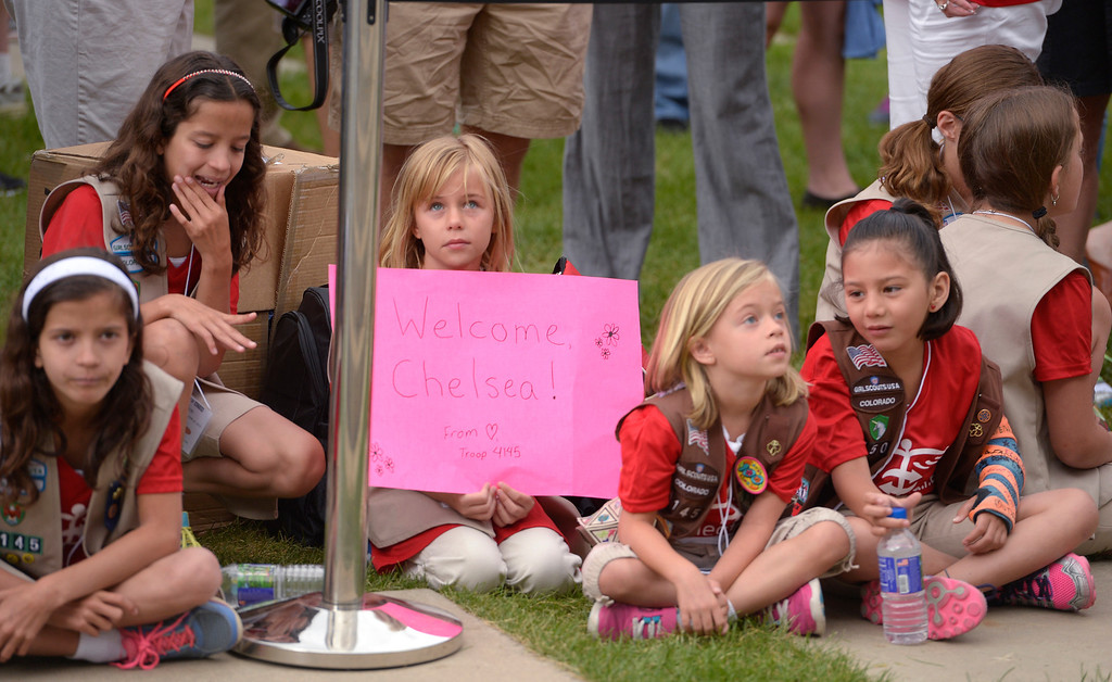 ". Girl Scout Emma Harma, 10, holds up a sign as the rest of Troop 4145 patiently wait the arrival of Chelsea Clinton on Sunday, June 22, 2014. Clinton held a press conference to kick off ""Day of Action\"" in Denver June 22, 2014, ahead of CGI America. Volunteers worked with six nonprofit organizations in the Denver metro area including the Boys & Girls clubs, Denver Parks and Recreation, Food Bank of the Rockies, Habitat for Humanity, Mi Casa Resource Center and Project C.U.R.E. (Photo by John Leyba/The Denver Post)"