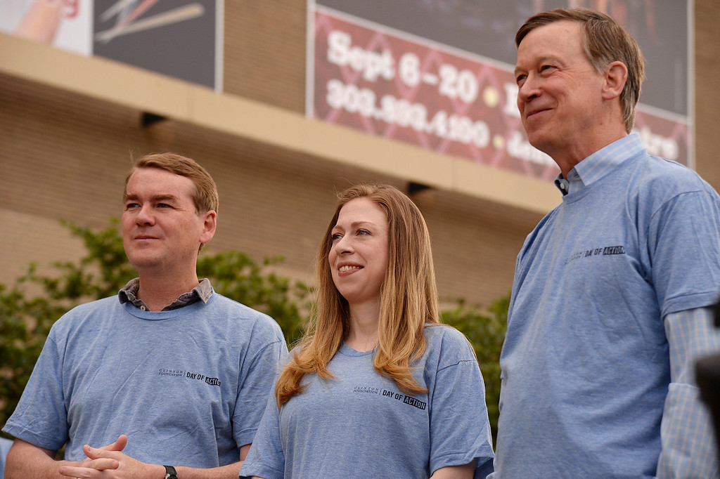 ". Senator Michael Bennet stands with Chelsea Clinton and Gov. John Hickenlooper during a press conference to kick off ""Day of Action\"" in Denver June 22, 2014 ahead of CGI America.  (Photo by John Leyba/The Denver Post)"