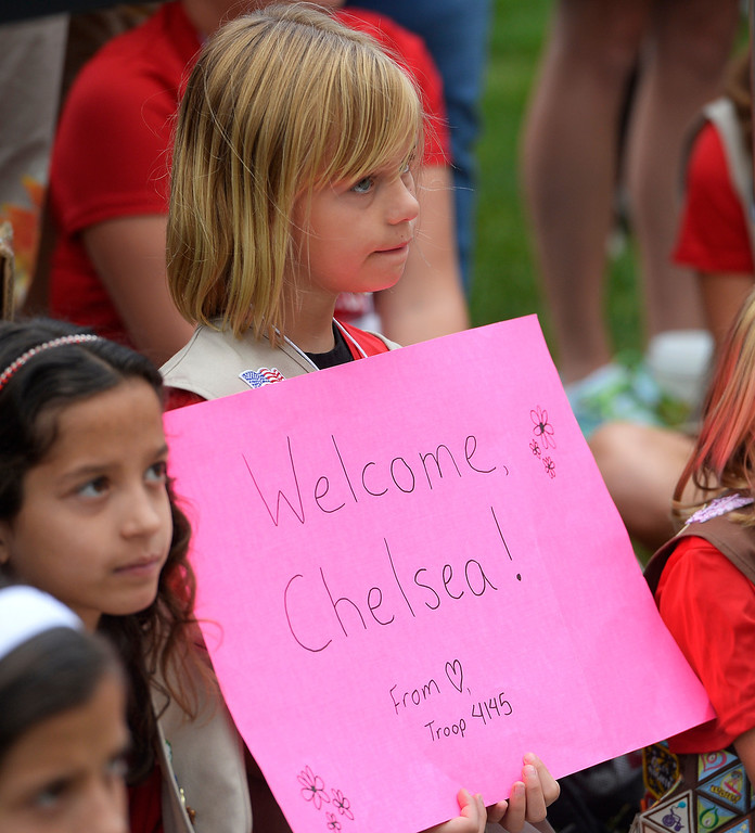 . Girl Scout Emma Harma, 10, from Troop 4145, holds up a sign welcoming Chelsea Clinton.   (Photo by John Leyba/The Denver Post)