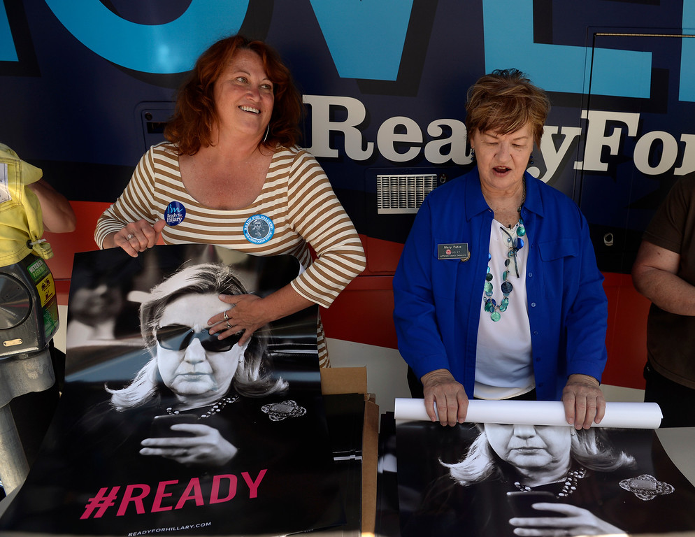 """. Mary Patee, right, and Christine Laursen from the Jefferson County Democrats, hand out posters of Hillary Clinton outside the Tattered Cover Bookstore. Hillary Rodham Clinton signs about 1,000 copies of her newly released book \""""Hard Choices\"""" for fans at the Tattered Cover Bookstore on E. Colfax Ave. in Denver on Monday, June 23, 2014. (Photo by Kathryn Scott Osler/The Denver Post)"""