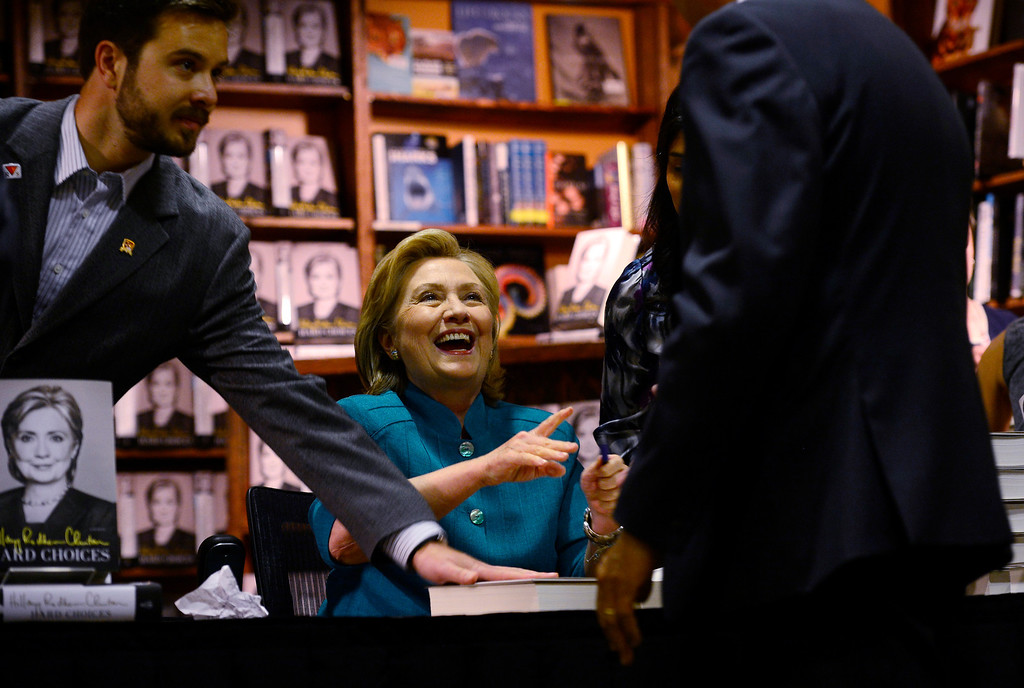 """. Hillary Rodham Clinton signs about 1,000 of her newly released book \""""Hard Choices\"""" for fans at the Tattered Cover Bookstore on E. Colfax Ave. in Denver on Monday, June 23, 2014. (Photo by Kathryn Scott Osler/The Denver Post)"""