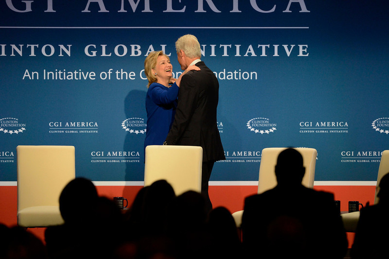. Former Secretary of State, Hillary Rodham Clinton, left, greets her husband, former President of the United States, Bill Clinton after Bill introduced Hillary  for the Clinton Global Initiative Tuesday morning, June 24, 2014 at the Sheridan Downtown Denver.  (Photo By Andy Cross / The Denver Post)
