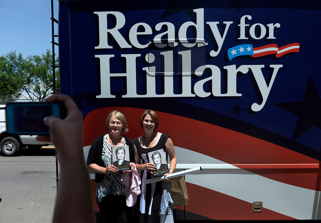 """. Holding their recently signed books, Kristina Mordecai, right and her mother Donna Riley have their photo taken outside the Tattered Cover Bookstore. Hillary Rodham Clinton signs about 1,000 copies of her newly released book \""""Hard Choices\"""" for fans at the Tattered Cover Bookstore on E. Colfax Ave. in Denver on Monday, June 23, 2014. (Photo by Kathryn Scott Osler/The Denver Post)"""