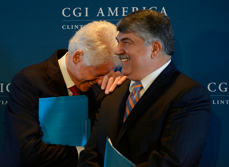 . Former President, Bill Clinton, left, has a laugh with Richard Trumka, President, AFL-CIO during a press conference at the Clinton Global Initiative at the Sheridan Downtown Denver, Tuesday afternoon, June 24, 2014. President Clinton and guests gave an update on a CGI Commitment to Action by the AFL-CIO, to invest $10 billion in infrastructure projects.  (Photo By Andy Cross / The Denver Post)