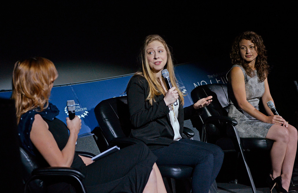 . Kari Byron, Co-Host of Discovery Channel�s Mythbusters, left, Chelsea Clinton, center, and Debbie Sterling, founder and CEO of GoldieBlox, host From STEM to Success: A No Ceilings Conversation at the Denver Museum of Nature and Science Planetarium, June 23, 2014. The discussion focused attracting girls and women to scientific and technological fields. (Photo by RJ Sangosti/The Denver Post)