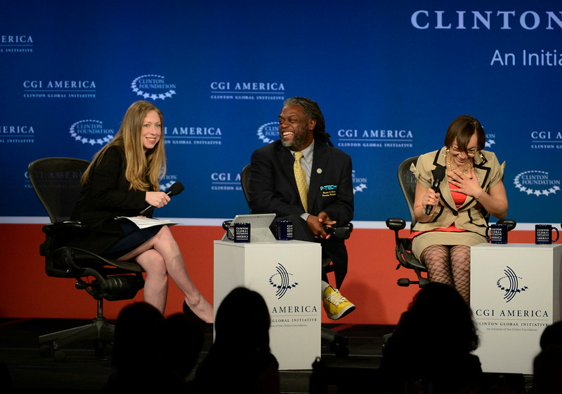 . Chelsea Clinton, left, has a laugh with panelists, Rashid Ferrod Davis, founding principal, Pathways in Technology Early College High School, New York City, center, and Tiffany Lewin, systems and hardware analyst, New York Presbyterian Hospital, during the lunch Plenary session, �Charting a New Course: Education and Employing America\'s Future leaders at the Clinton Global Initiative at the Sheridan Downtown Denver, Tuesday afternoon, June 24, 2014. (Photo By Andy Cross / The Denver Post)