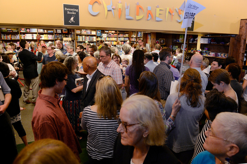 """. A crowd gathers and lines up to see Hillary Rodham Clinton and get their books signed Clinton is signing about 1,000 copies of her newly released book \""""Hard Choices\"""" for fans at the Tattered Cover Bookstore on E. Colfax Ave. in Denver on Monday, June 23, 2014. (Photo by Kathryn Scott Osler/The Denver Post)"""