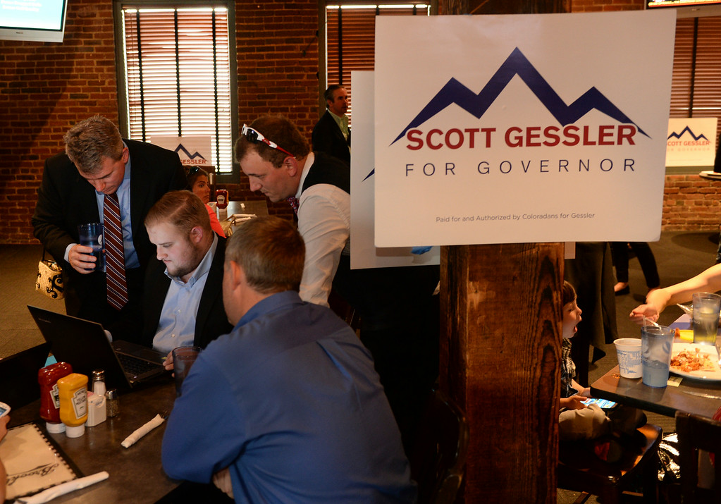 . Scott Gessler, left, tracked election results with campaign staff during a watch party Tuesday night, June 24, 2014 at Brooklyns. Photo by Karl Gehring/The Denver Post
