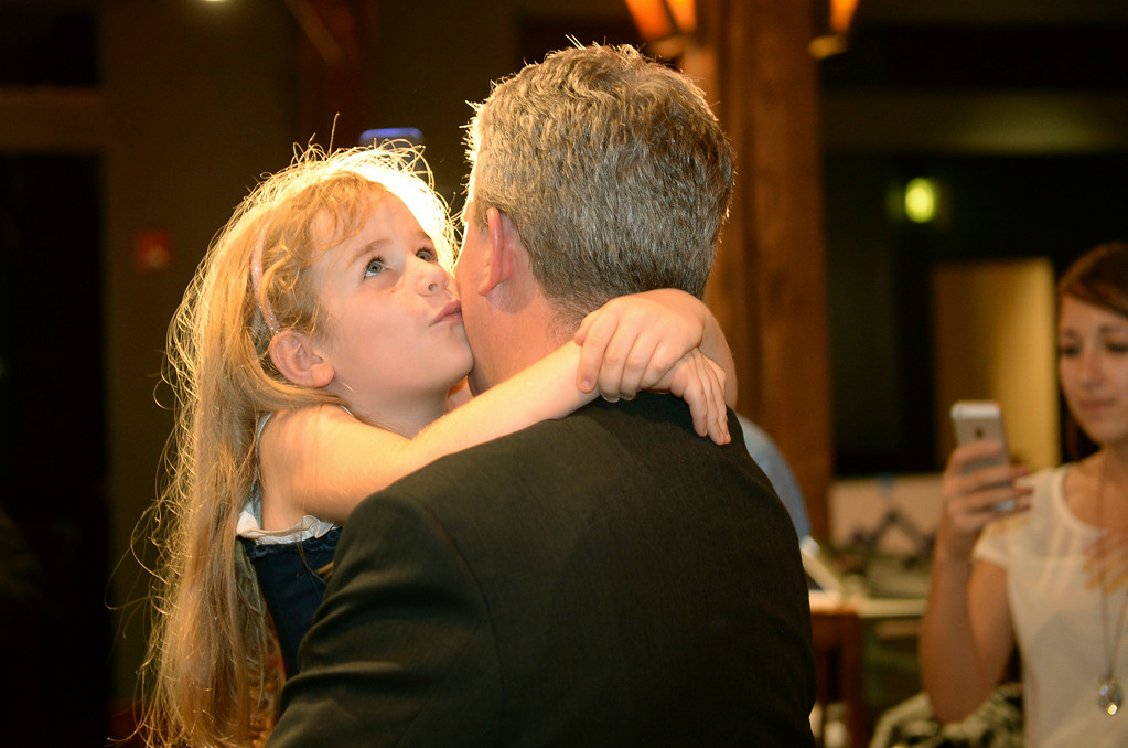 . Sofia Gessler, age 6, kissed her father Scott Gessler as he prepared to go on camera for an interview Tuesday night. Gessler told his supporters he would not win shortly before 8:00 p.m. Tuesday night, June 24, 2014 at Brooklyns. He threw his support behind Bob Beauprez. Photo by Karl Gehring/The Denver Post