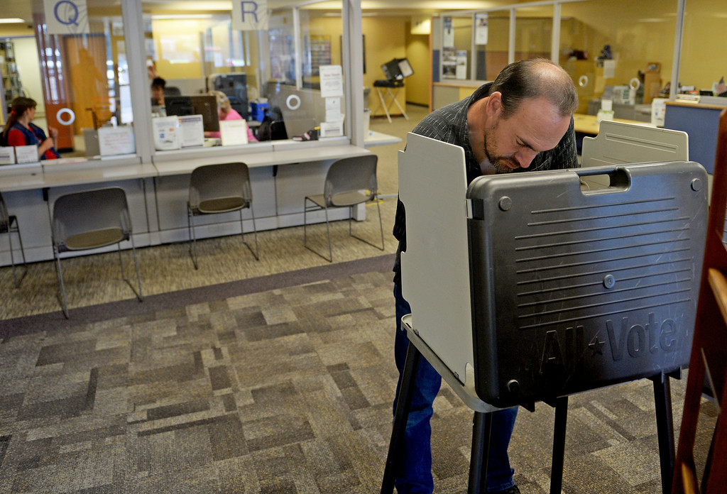 . Charles Wood votes at  Arapahoe County Clerk and Recorders offices in Aurora, June 24, 2014. Today is the final day of voting in the primaries in Colorado. (Photo by RJ Sangosti/The Denver Post)